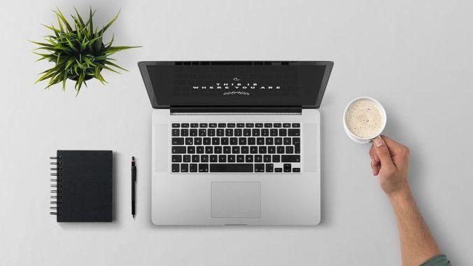 laptop desk pen notebook coffee
